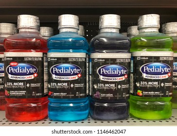 San Leandro, CA - July 30, 2018: Grocery store shelf with bottles of Pedialyte, helps prevent dehydration, replaces nutrients and electrolytes lost through vomiting, diarrhea for infants and children.