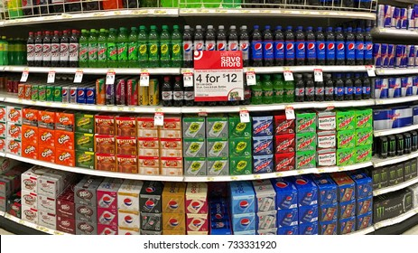San Leandro, CA - October 12, 2017: Grocery store shelf with various brands of soda in cans. Pepsi Co is one of the largest corporations in the non-alcoholic beverage industry.