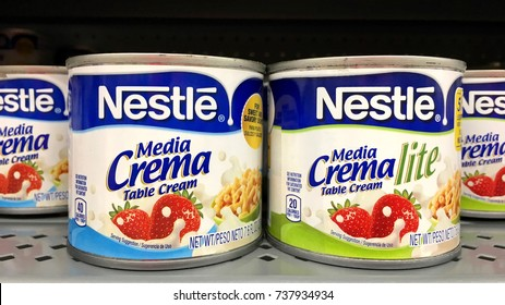 San Leandro, CA - October 18, 2017: Grocery store shelf with cans of Nestle brand media crema regular and light. Nestle  is a Swiss transnational company headquartered in Vevey, Vaud, Switzerland.