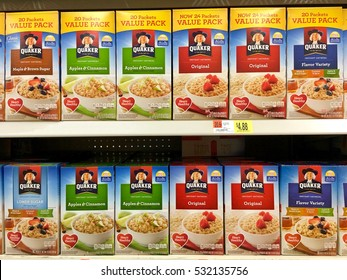 San Leandro, CA - October 28, 2016: Grocery shelf with boxes of Quaker brand instant oatmeals.