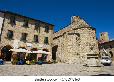 San Leo, Italy - May 14, 2013: Beautiful square with medieval stone buildings in San Leo, Italy.