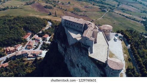 San Leo, Rimini/Italy - 08/20/2018: Aerial view of the castle of San Leo, the prison-fortress where the Count Cagliostro, esotericist, alchemist, Italian mason died