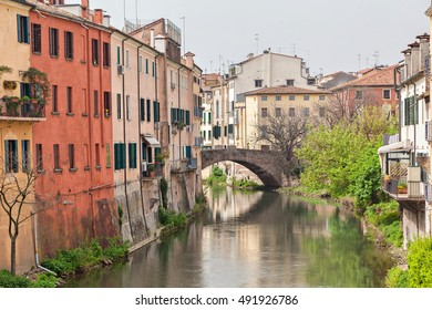 San Leonardo bridge over canal and colorful houses in Padua, Italy