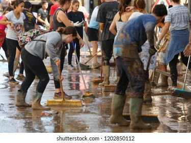 San Llorenc, Mallorca / Spain - October 11, 2018: Villagers and volunteers remove debris after heavy flash floods in the village of San Llorenc killing many people in mallorca