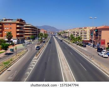 SAN LUIS DE SABINILLAS, Spain - August 2018: Main coastal road passing trough the town