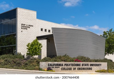 San Luis Obispo, CA, USA - June 7 2021: California Polytechnic State University. Grant M. Brown engineering building on street intersection at entrance to campus under blue cloudscape.