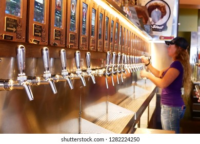 San Luis Obispo, California : November 12 2018 : Customer holding a glass and taping beer into it,  Blast 825 Taproom, San Luis Obispo, California, USA