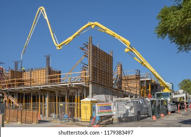SAN LUIS OBISPSO, CALIFORNIA - FEBRUARY 08, 2018: Pumping concrete being pumped at a construction site for retail and residential units in San Luis Obispo.