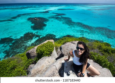 SAN ANDRÉS/COLOMBIA - MARCH 03 2014: a woman is viewing the turquoise caribbean sea, in San Andrés island, Colombia