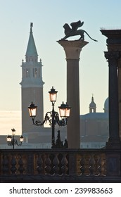 San Marco columns with winged lion at east side of piazza San Marco in Venice, San Giorgio Maggiore church is visible at the other side of Grand Canal, Italy