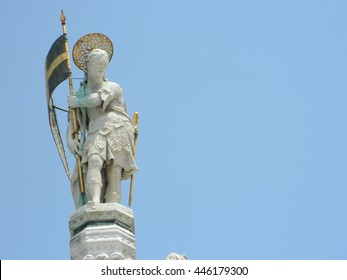 San Marco's statue on top of the San Marco's cathedral facade, in the famous San Marco's square, in Venice.