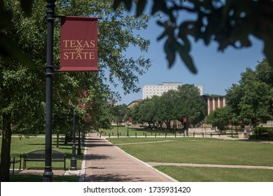 San Marcos, Texas - May 19 2020: Texas State University banner and campus
