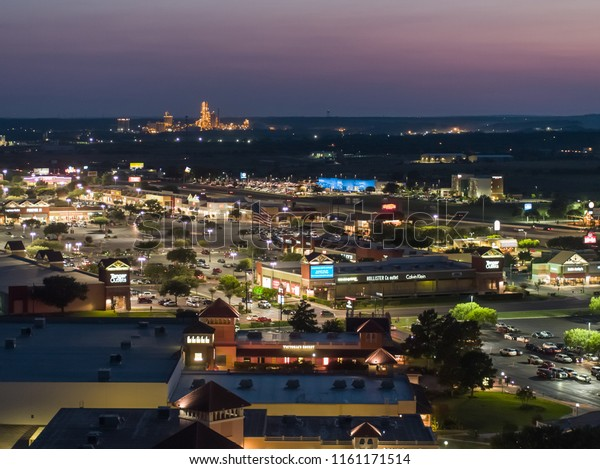 SAN MARCOS, TEXAS, USA - AUGUST 1, 2018: Aerial image of outlet shops San Marcos Texas at twilight night with lights