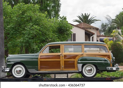 SAN MARINO, CA/USA - JUNE 12, 2016: 40s DeSoto Woody wagon loaded on the deck of an auto transport truck.