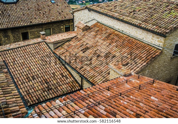 San Marino old town brown tile roofs. Tile roofs in the old city town center. up view. tile roof background. many, a lot roofs