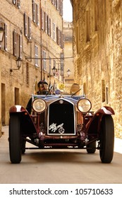 SAN MARINO RSM - MAY 18: Claudio Scalise and D. Claramunt transit during the 2012 edition of 1000 Miglia vintage car race they will win, aboard their 1933 Alfa Romeo 6C, on May 18, 2012 in San Marino