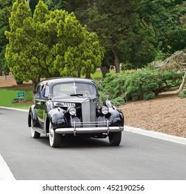 SAN MARINO/CALIFORNIA - JUNE 12, 2016: A vintage 1940's Packard cruises along a narrow road in San Marino, California USA