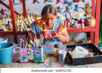 San Martin Tilcajete, Oaxaca / Mexico - September 19th, 2018: Artists of the woodcarving artisan village of San Martin Tilcajete