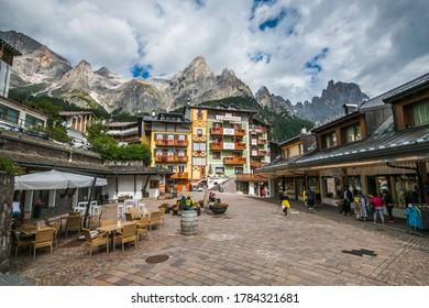 SAN MARTINO DI CASTROZZA, ITALY - JULY 21, 2020: View of square in the center of San Martino di Castrozza city with Pale di San Martino dolomites in the background, Trentino