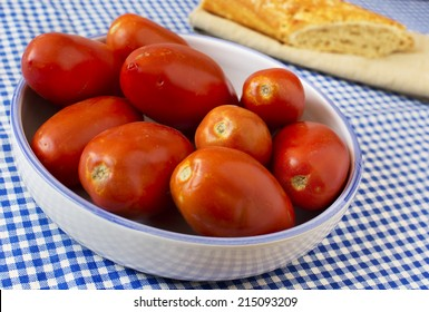 San Marzano tomatoes in a mediterranean plate and table.