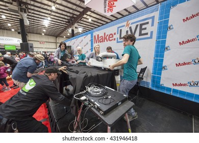 SAN MATEO, CA May 20 2016 - Glowforge employees disassemble their presentation equipment at the 11th annual Bay Area Maker Faire at the San Mateo County Event Center.