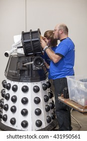 SAN MATEO, CA May 20 2016 - Repair work on a Dalek during the 11th annual Bay Area Maker Faire at the San Mateo County Event Center.