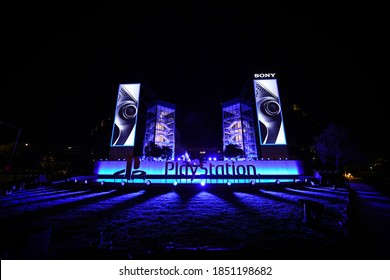 SAN MATEO, CALIFORNIA / USA - November 9, 2020: Presentation show of new product from Sony, wireless white console PlayStation 5, ps5 and gamepad, game console on PlayStation USA headquarters building