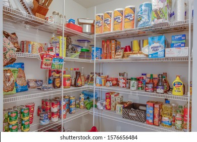 San Mateo, Florida / USA - December 2 2019: A well stocked large pantry with canned goods and paper products