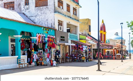 San Miguel, Cozumel, Mexico - April 16, 2018: Tourists visit shops and restaurants in downtown Cozumel Mexico during spring break season