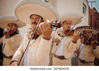 San Miguel de Allende, Guanajuato / Mexico - September 26 206: Four mariachis perform on street corner