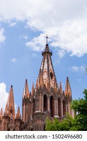 San Miguel de Allende, Guanajuato, México, July 2019; partial view of San Miguel Arcángel church on a bright, sunny day.