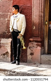 San Miguel de Allende - June 2015: Mariachi trumpet player holding his trumpet on the street.