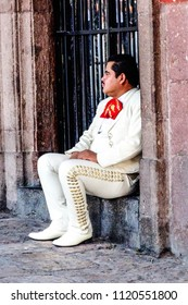 San Miguel de Allende - June 2015: Mariachi sitting on the street.