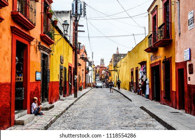 San Miguel de Allende, Mexico. June 2015. Beautiful narrow street made out of stone with colorful houses on.
