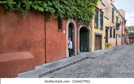 San Miguel de Allende, Mexico - July 21, 2015.  A chef taking a break from her duties in beautiful San Miguel de Allende, Mexico.