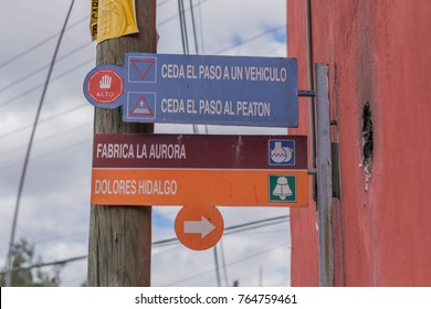 San Miguel de Allende, Mexico-October 26, 2017: street sign, in between a red wall and a telephone poll