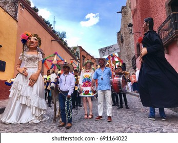 SAN MIGUEL DE ALLENDE/MEXICO: August 4, 2017 Wedding Procession in the streets of San Miguel de Allende including Mojiagangas giant puppets of the Bride and Groom and musicians and guests