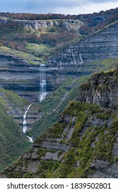 San Miguel waterfall in autumnal landscape of the Angulo Valley within the Mena Valley municipality in the Merindades region of the province of Burgos in Castilla y Leon of Spain, Europe - Shutterstock ID 1839502801