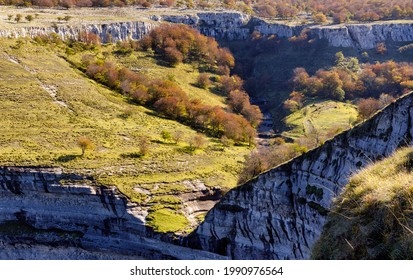 San Miguel waterfall is the limit between Losa Valley and Mena Valley, close to Peña Angulo peak, in The Merindades, Burgos, in the north of Spain.  - Shutterstock ID 1990976564