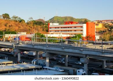 "San Miguelito, Panama - Jan 30, 2019: Line 2 of Metro de Panama and ""San Miguel Arcángel"" hospital"