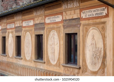 San Miniato, Pisa, Italy - November 26, 2017: The frescoes and latin mottos on the facade of the Bishop's Seminary, in the main square of the village, painted in 1700 by Francesco Chimenti.