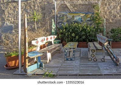 SAN PANTALEO, SARDINIA, ITALY - MARCH 3, 2019: Artisan small furniture objects on display outdoors on a sunny day on March 3, 2019 in San Pantaleo, Sardinia, Italy.