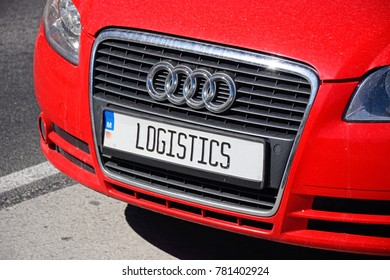 SAN PAWL, MALTA - APRIL 2, 2017 - Radiator grill and logistics numberplate on a red Audi car, Malta, Europe, April 2, 2017.