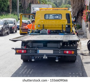 San Pedro Alcantara/Spain 15. Septembre 2109: tow truck wrecker with empty body ready for another broken car or other vehicle, breakdown truck, recovery vehicle or a breakdown lorry