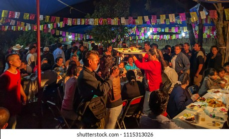 SAN PEDRO APOSTAL, OAXACA-July 2, 2016. A host family serves a meal to the hundreds of local residents to celebrate the Calenda San Pedro, an annual regional calendar event that honors St Peter.