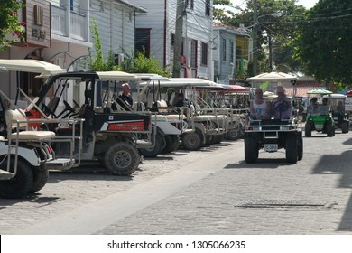 San Pedro, Belize – January 7, 2016: View of a golf cart parking in the middle of the city