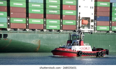 SAN PEDRO, CA - APRIL 08, 2015: Crowley Tugboat ADMIRAL at the Port of Los Angeles. Tugboats are powerful for their size and strongly built. They maneuvers vessels by pushing or towing them.