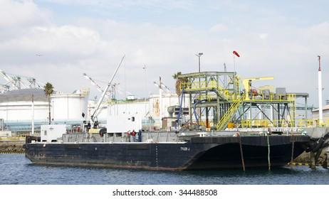 SAN PEDRO, CA - NOVEMBER 24, 2015: Berth 240 Maine Fuel Facility at the Port of Los Angeles. The Port of LA has 7 liquid bulk facilities comprising 114 acres to handle both import and export.