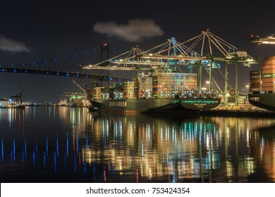 SAN PEDRO, CALIFORNIA - NOVEMBER 10, 2017: Dock workers at the Port of Los Angeles continue to load and unload Evergreen cargo freighters. Day and night, the work continues.