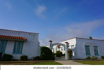 San Pedro, California USA - August 12, 2018: A classic California bungalow court apartment complex in Spanish Revival style with a distinctive arched courtyard entrance